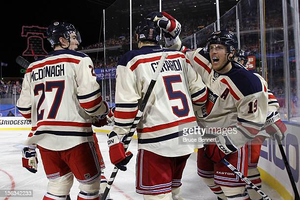Brad Richards of the New York Rangers celebrates with Ryan McDonagh and Dan Girardi after scoring a goal in the third period against the Philadelphia...