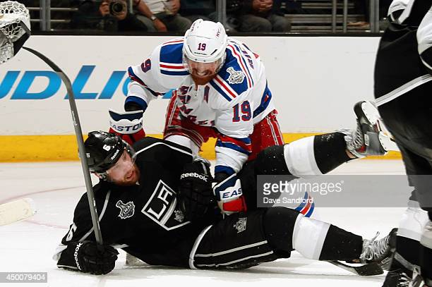 Brad Richards of the New York Rangers falls on top of Jake Muzzin of the Los Angeles Kings during the third period of Game One of the 2014 Stanley...