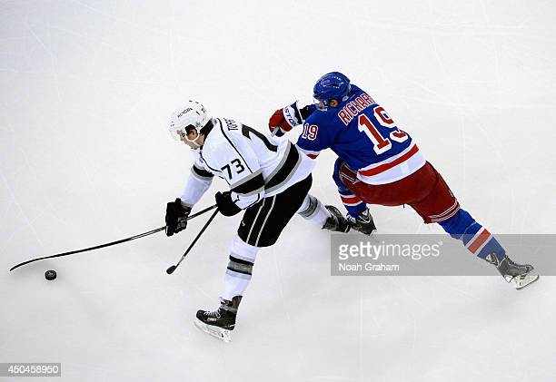 Brad Richards of the New York Rangers reaches to try and stop Tyler Toffoli of the Los Angeles Kings in the first period of Game Four of the 2014...
