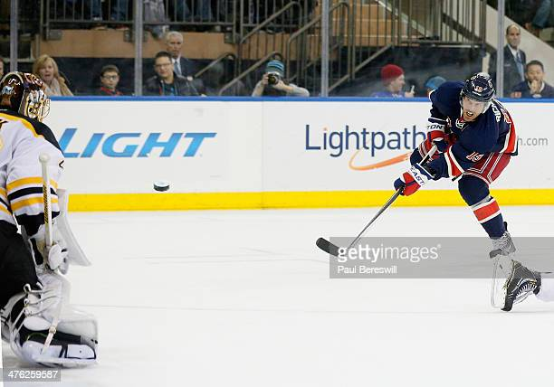 Brad Richards of the New York Rangers shoots the puck past goalie Tuukka Rask of the Boston Bruins for a goal in the second period of an NHL hockey...