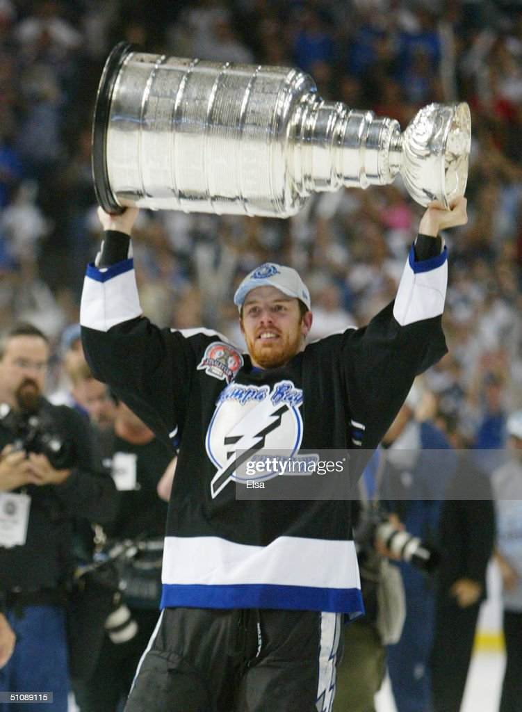 Brad Richards #19 of the Tampa Bay Lightning holds the Stanley Cup above his head after the victory over the Calgary Flames in Game seven of the NHL Stanley Cup Finals on June 7, 2004 at the St. Pete Times Forum in Tampa, Florida. The Lightning defeated the Flames 2-1.