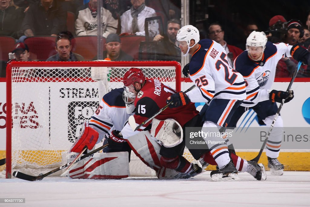 Brad Richardson #15 of the Arizona Coyotes attempts a shot on goaltender Al Montoya #35 of the Edmonton Oilers as Darnell Nurse #25 and Adam Larsson #6 defend during the third period of the NHL game at Gila River Arena on January 12, 2018 in Glendale, Arizona. The Oilers defeated the Coyotes 4-2.