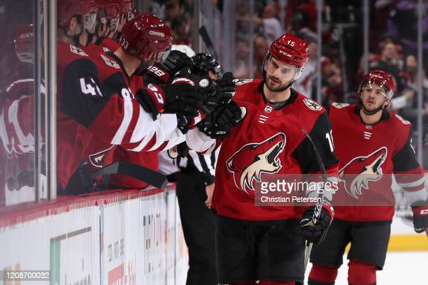 Brad Richardson of the Arizona Coyotes celebrates with teammates on the bench after scoring a short-handed goal against the Florida Panthers during...