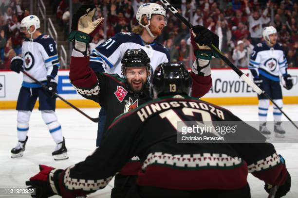 Brad Richardson of the Arizona Coyotes celebrates with Vinnie Hinostroza after Richardson scored a goal against the Winnipeg Jets during the first...