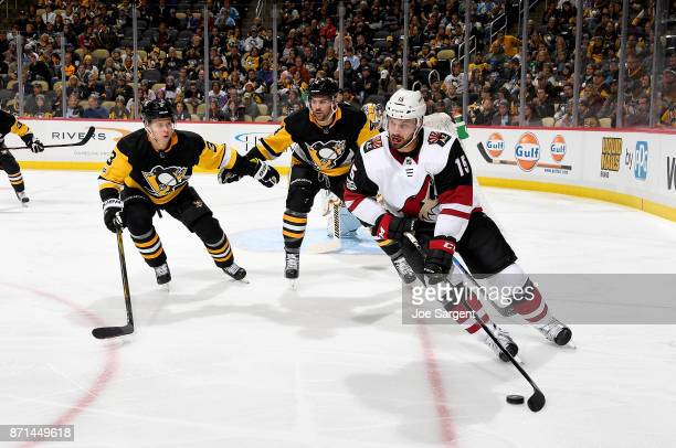 Brad Richardson of the Arizona Coyotes handles the puck against Olli Maatta and Justin Schultz of the Pittsburgh Penguins at PPG Paints Arena on...