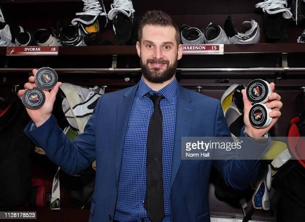 Brad Richardson of the Arizona Coyotes holds the pucks from his four goals against the Vancouver Canucks following a 5-2 victory at Gila River Arena...