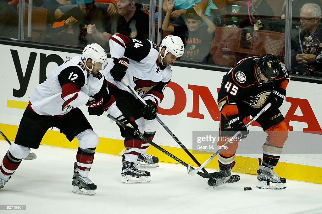 Brad Richardson #12 of the Arizona Coyotes, Kyle Chipchura #24 of the Arizona Coyotes and Sami Vatanen #45 of the Anaheim Ducks skate for the puck during the third period of a game at Honda Center on October 14, 2015 in Anaheim, California.