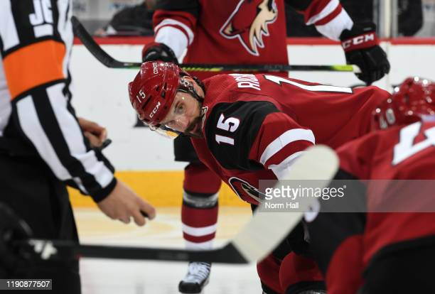 Brad Richardson of the Arizona Coyotes looks at teammate Michael Grabner prior to taking a face-off against the Anaheim Ducks at Gila River Arena on...