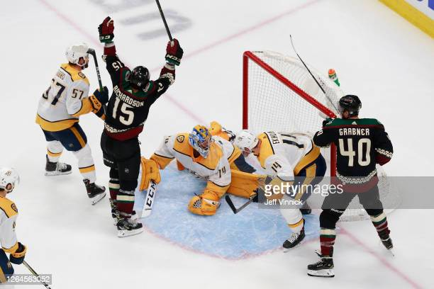 Brad Richardson of the Arizona Coyotes shoots the puck past Juuse Saros of the Nashville Predators for a game winning overtime goal at 5:27 to win...