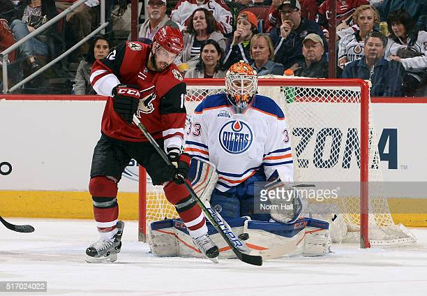Brad Richardson of the Arizona Coyotes tries to redirect the puck past goaltender Cam Talbot of the Edmonton Oilers during the second period at Gila...