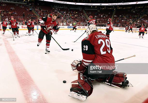 Brad Richardson of the Arizona Coyotes warms up with goaltender Anders Lindback before a game against the New York Islanders at Gila River Arena on...