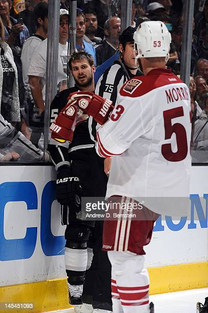 Brad Richardson of the Los Angeles Kings has words with Derek Morris of Phoenix Coyotes in Game Four of the Western Conference Finals during the 2012...