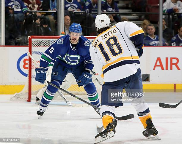 Brad Richardson of the Vancouver Canucks attempts to block a shot by Michael Del Zotto of the Nashville Predators during their NHL game at Rogers...