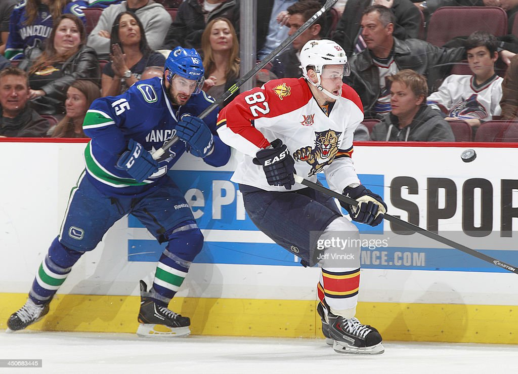 Brad Richardson #15 of the Vancouver Canucks pursues Tomas Kopecky #82 of the Florida Panthers during their NHL game at Rogers Arena on November 19, 2013 in Vancouver, British Columbia, Canada. Florida won 3-2 in a shootout.