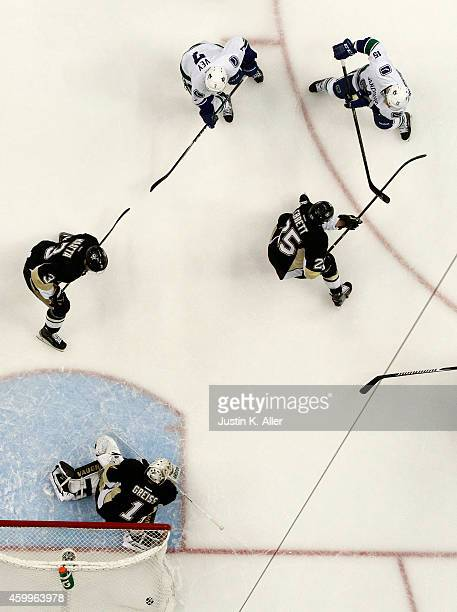 Brad Richardson of the Vancouver Canucks scores against Thomas Greiss of the Pittsburgh Penguins in the first period during the game at Consol Energy...