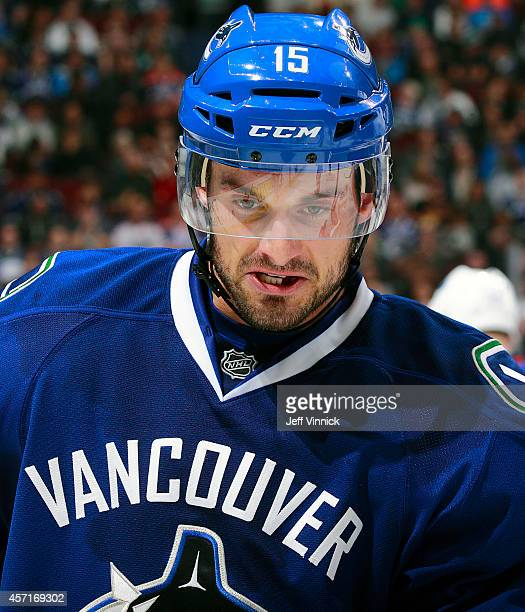 Brad Richardson of the Vancouver Canucks skate to the bench during their NHL game against the Edmonton Oilers at Rogers Arena October 11, 2014 in...