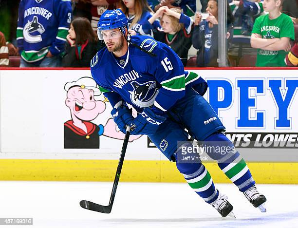 Brad Richardson of the Vancouver Canucks skates up ice during their NHL game against the Edmonton Oilers at Rogers Arena October 11, 2014 in...