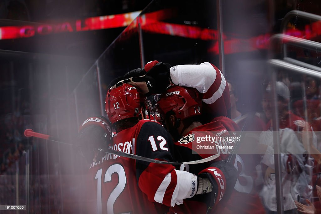 Brad Richardson #12, Oliver Ekman-Larsson #23 and Anthony Duclair #10 of the Arizona Coyotes celebrate after Duclair scored a goal in an overtime period against the San Jose Sharks during the NHL preseason game at Gila River Arena on October 2, 2015 in Glendale, Arizona. The Sharks defeated the Coyotes 3-0.