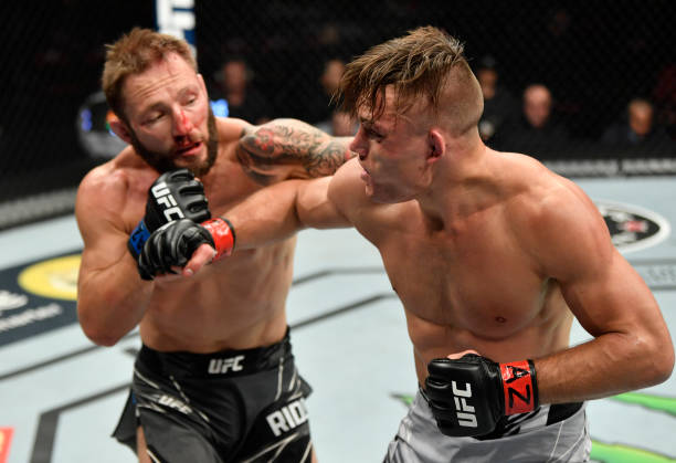 Brad Riddell of New Zealand punches Drew Dober in their lightweight fight during the UFC 263 event at Gila River Arena on June 12, 2021 in Glendale,...