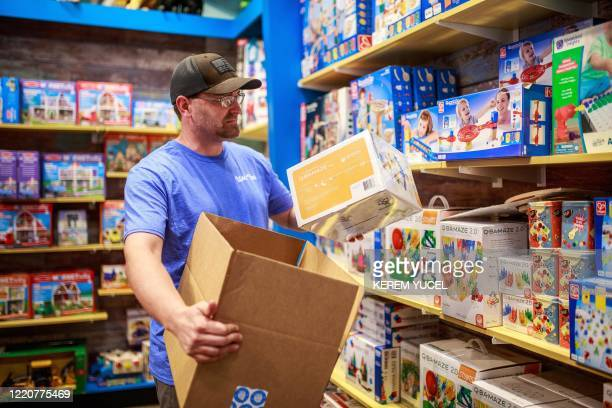 Brad Ruoho, owner of the Legacy Toys, works in his Mall of America store on June 17, 2020 in Bloomington, Minnesota. - The US economy continues to...