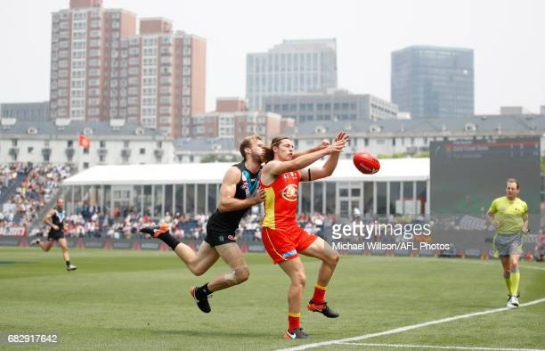 Brad Scheer of the Suns and Jack Hombsch of the Power compete for the ball during the 2017 AFL round 08 match between the Gold Coast Suns and Port...
