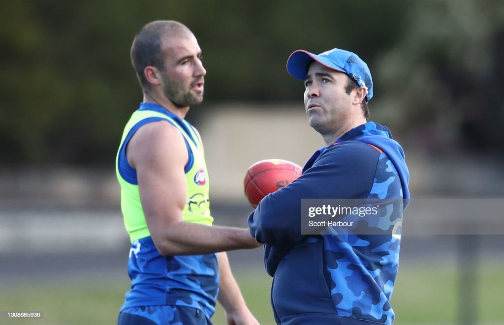 Brad Scott, coach of the Kangaroos and Ben Cunnington of the Kangaroos talk during an North Melbourne Kangaroos AFL training session at Arden Street Ground on August 1, 2018 in Melbourne, Australia.