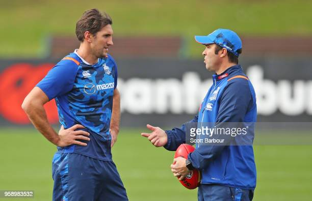 Brad Scott coach of the Kangaroos speaks to Jarrad Waite of the Kangaroos during a North Melbourne Kangaroos AFL training session at Arden Street...