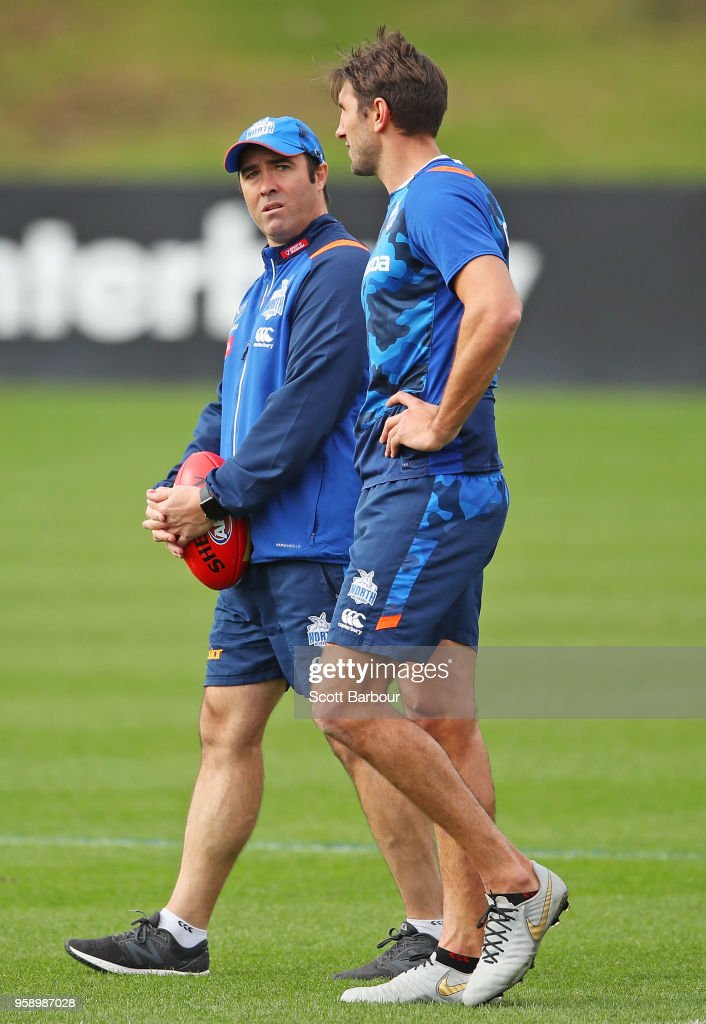 Brad Scott, coach of the Kangaroos speaks to Jarrad Waite of the Kangaroos during a North Melbourne Kangaroos AFL training session at Arden Street Ground on May 16, 2018 in Melbourne, Australia.