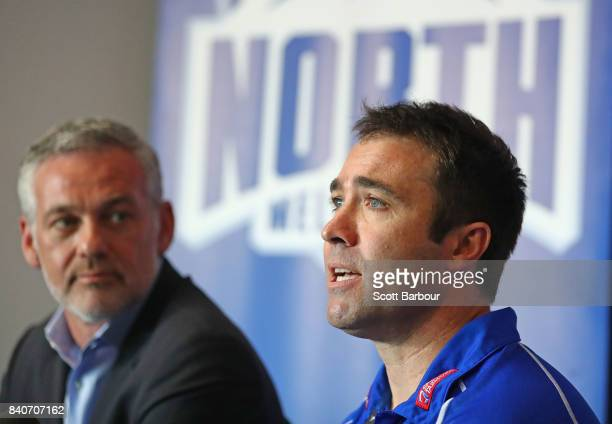 Brad Scott coach of the Kangaroos speaks to the media along with Kangaroos Chairman Ben Buckley during a North Melbourne Kangaroos AFL press...