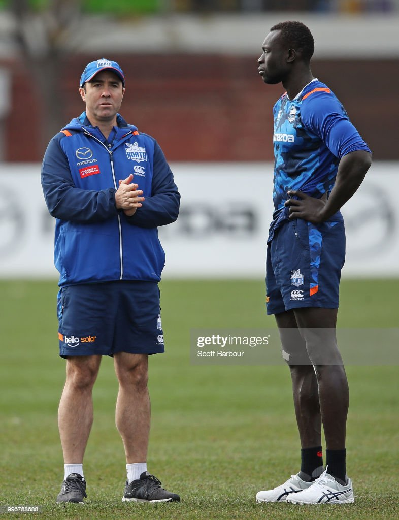 Brad Scott, coach of the Kangaroos talks to Majak Daw of the Kangaroos during a North Melbourne Kangaroos Training Session on July 12, 2018 in Melbourne, Australia.