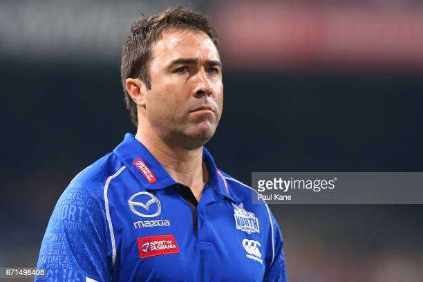 Brad Scott coach of the Kangaroos walks to the changerooms after being defeated during the round five AFL match between the Fremantle Dockers and the...