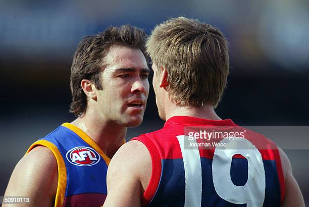 Brad Scott of the Lions and Peter Vardy of Melbourne exchange words during the AFL Match between the Brisbane Lions and Melbourne on May 30 2004 in...