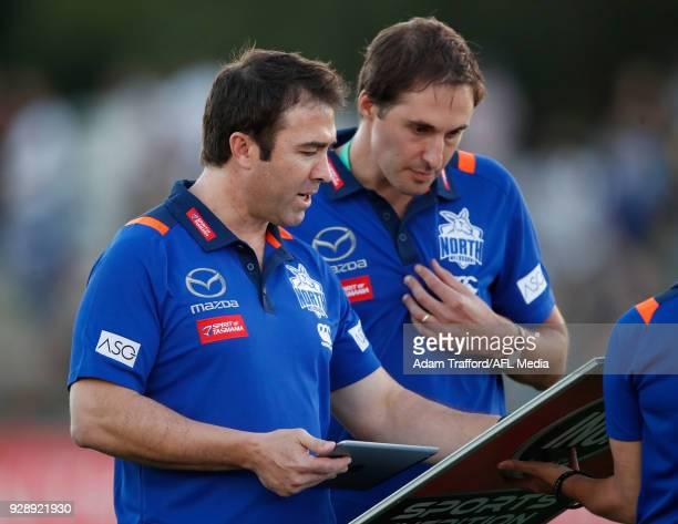 Brad Scott Senior Coach of the Kangaroos chats to Cameron Joyce GM of Football during the AFL 2018 JLT Community Series match between the Richmond...