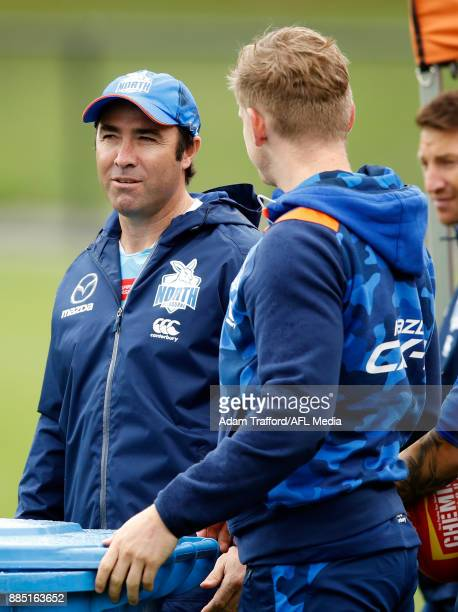 Brad Scott Senior Coach of the Kangaroos chats to Jack Ziebell of the Kangaroos during the North Melbourne Kangaroos training session at Arden St on...