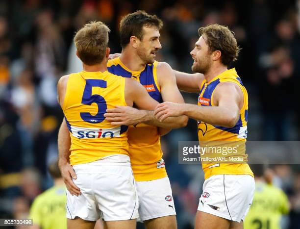 Brad Sheppard Eric Mackenzie and Mark Hutchings of the Eagles celebrate after the final siren during the 2017 AFL round 15 match between the Western...