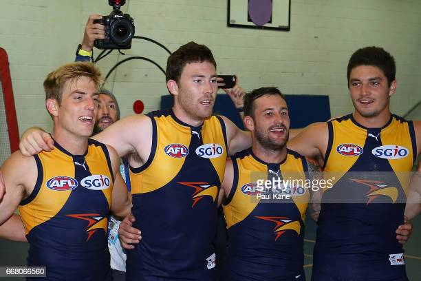 Brad Sheppard Jeremy McGovern Chris Masten and Tom Barrass of the Eagles sing the club song after winning the round four AFL match between the West...