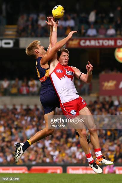 Brad Sheppard of the Eagles and Harry Cunningham of the Swans contest for the ball during the round four AFL match between the West Coast Eagles and...