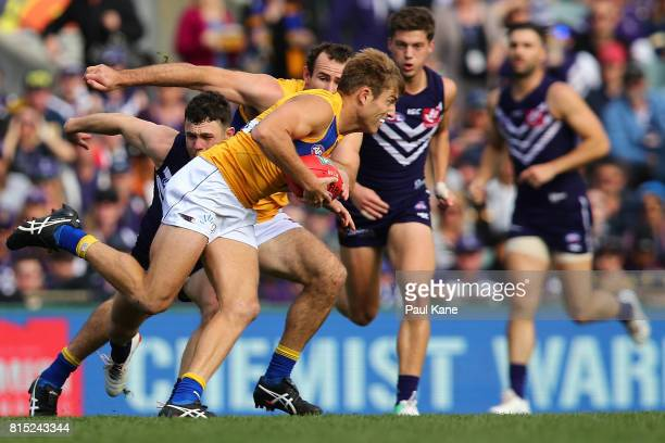 Brad Sheppard of the Eagles gathers the ball during the round 17 AFL match between the Fremantle Dockers and the West Coast Eagles at Domain Stadium...