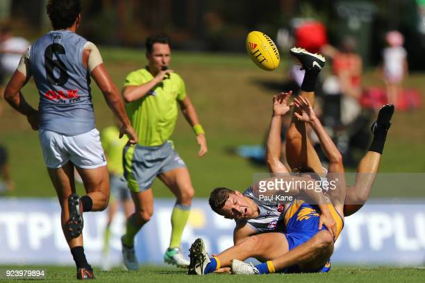 Brad Sheppard of the Eagles gets tackled by Jack Trengove of the Power during the JLT Community Series AFL match between the West Coast Eagles and...