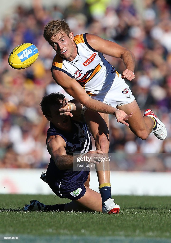 Brad Sheppard of the Eagles handballs before being tackled by Michael Barlow of the Dockers during the round one AFL match between the Fremantle Dockers and the West Coast Eagles at Patersons Stadium on March 23, 2013 in Perth, Australia.