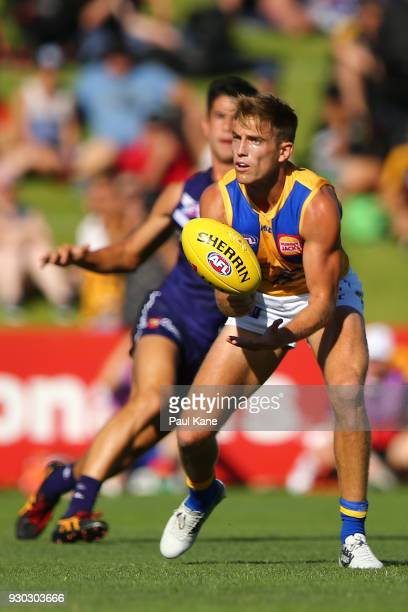 Brad Sheppard of the Eagles handballs during the JLT Community Series AFL match between the Fremantle Dockers and the West Coast Eagles at HBF Arena...