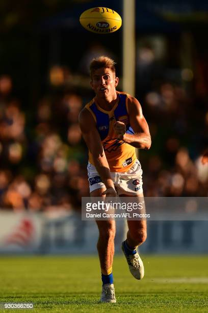 Brad Sheppard of the Eagles handpasses the ball during the AFL 2018 JLT Community Series match between the Fremantle Dockers and the West Coast...