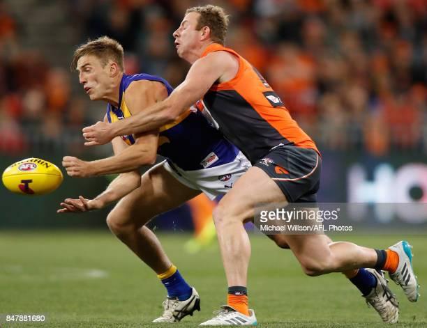 Brad Sheppard of the Eagles is tackled by Steve Johnson of the Giants during the 2017 AFL First Semi Final match between the GWS Giants and the West...