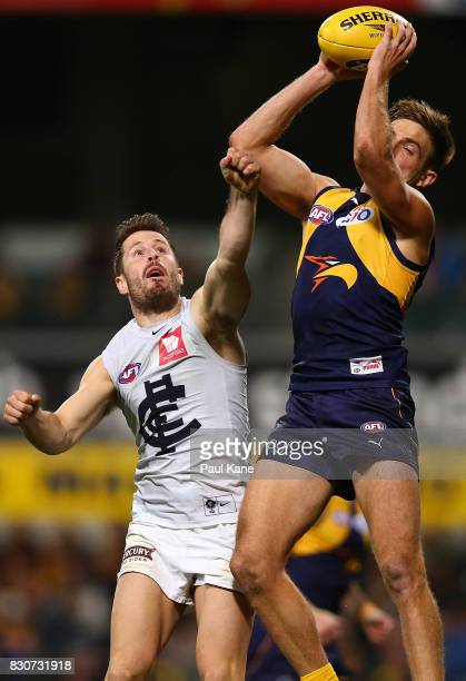 Brad Sheppard of the Eagles marks the ball against Matthew Wright of the Blues during the round 21 AFL match between the West Coast Eagles and the...
