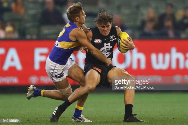 Brad Sheppard of the Eagles tackles Charlie Curnow of the Blues during the round five AFL match between the Carlton Blues and the West Coast Eagles...