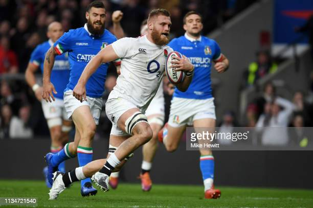 Brad Shields of England breaks before scoring a try during the Guinness Six Nations match between England and Italy at Twickenham Stadium on March 09...