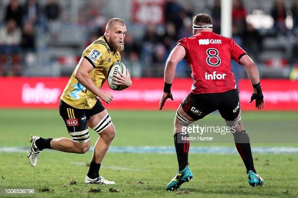 Brad Shields of the Hurricanes is tackled by Kieran Read of the Crusaders during the Super Rugby Semi Final match between the Crusaders and the...