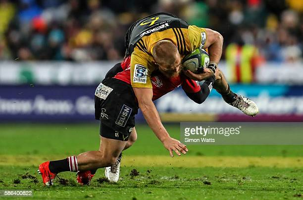Brad Shields of the Hurricanes is tackled during the 2016 Super Rugby Final match between the Hurricanes and the Lions at Westpac Stadium on August 6...
