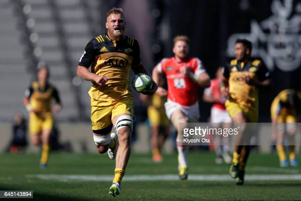 Brad Shields of the Hurricanes runs with the ball to score a try during the Super Rugby Rd 1 game between Sunwolves and Hurricanes at Prince Chichibu...