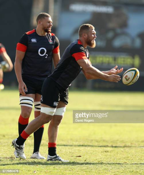 Brad Shields passes the ball watched by Nick Isiekwe during the England training session at Kings Park Stadium on June 13 2018 in Durban South Africa